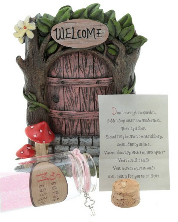 Pink fairy door with jar and scroll
