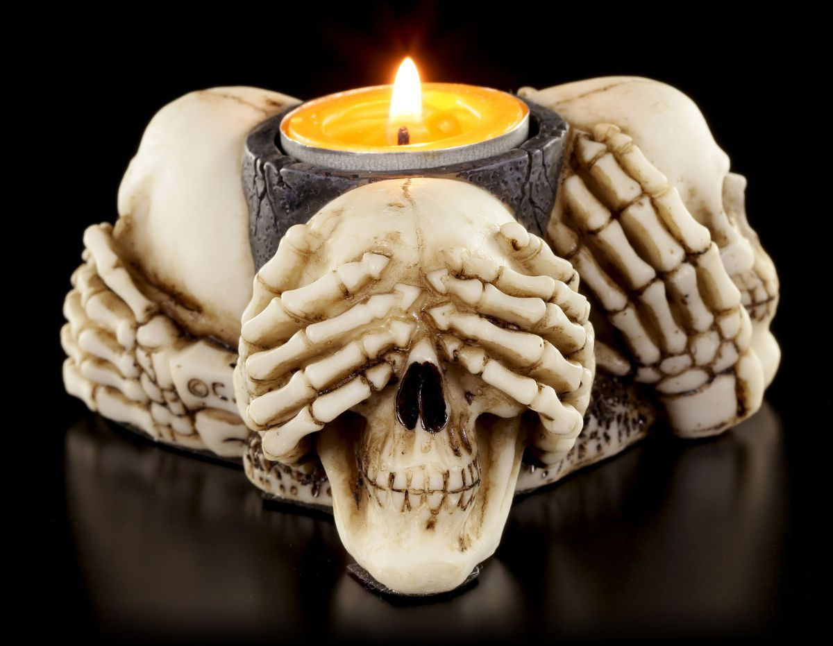 three wise skulls lit 3