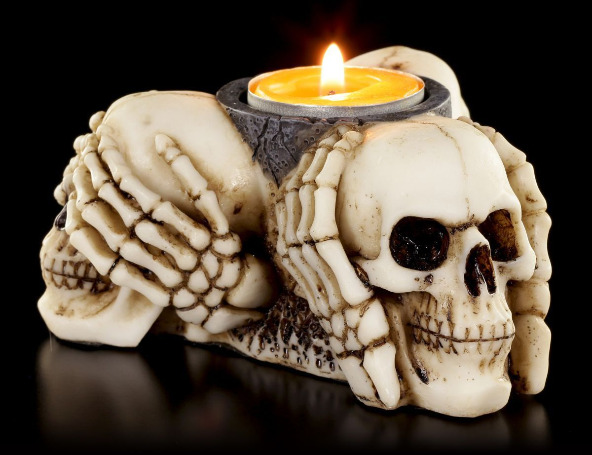 three wise skulls lit