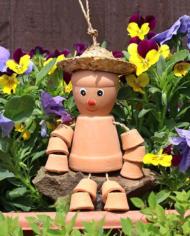 small terracotta pot man garden
